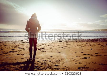 Woman looking out to sea Stock photo © IS2