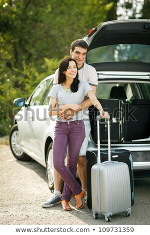 Family standing by car and luggage Stock photo © IS2