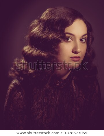 Image of charming happy woman with curly hair in dress smiling a Stock photo © deandrobot