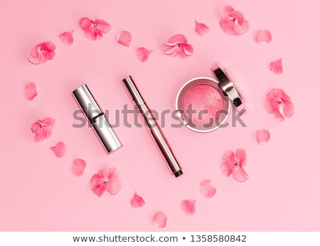 woman with pink lipstick and heart shaped shades stock photo © dolgachov