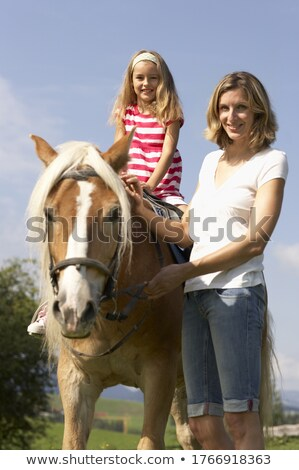 three adult woman outdoors with horse child Stock photo © Lopolo
