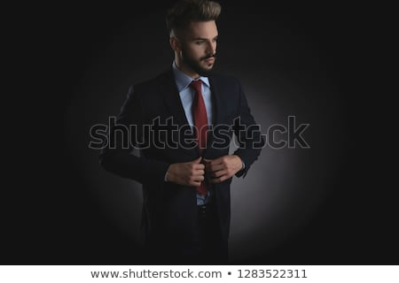 portrait of attractive businessman unbuttoning navy suit Stock photo © feedough
