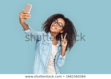 gyönyörű · boldog · mosolyog · tinilány · elvesz · fotó - stock fotó © dolgachov