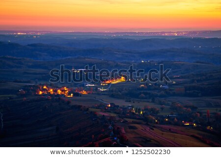 Evening view of villages and landscape below Kalnik mountain stock photo © xbrchx