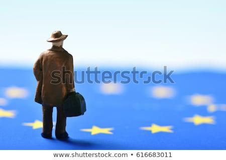 miniature traveler man and European Union flag Stock photo © nito