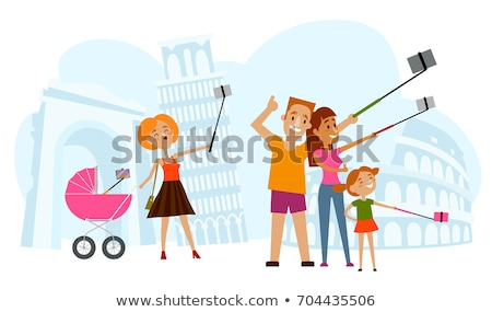happy family makes selfie on the background on background of Merdeka square and Sultan Abdul Samad B Stock photo © galitskaya