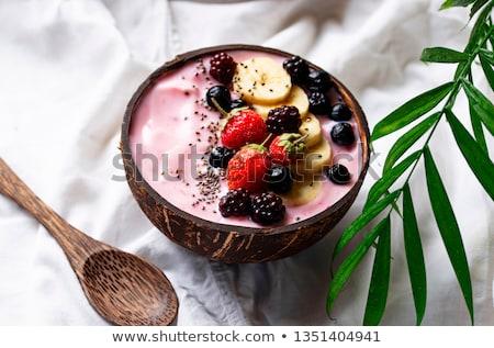Postre agradable crema Berry coco tazón Foto stock © furmanphoto