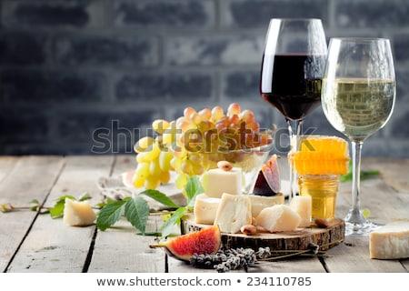 Various wine glasses on stone table Stock photo © karandaev