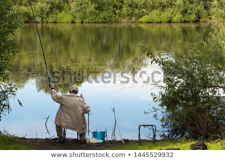 Fisherman fishing in pond Stock photo © jossdiim