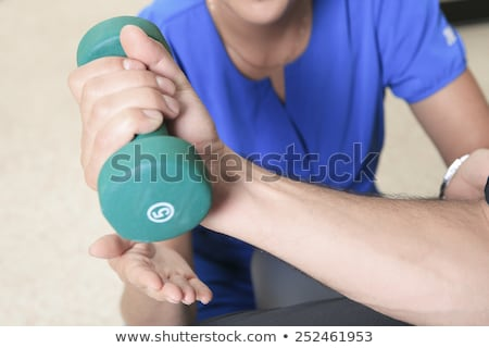 men at the physio with a dumbell Stock photo © Lopolo