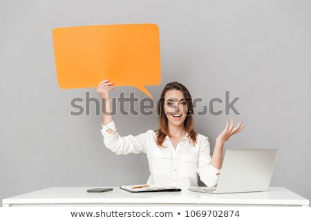 Woman holding laptop with speech bubbles Stock photo © ra2studio
