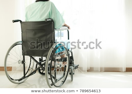 invalid or disabled woman sitting wheelchair looking window daylight stock photo © ia_64