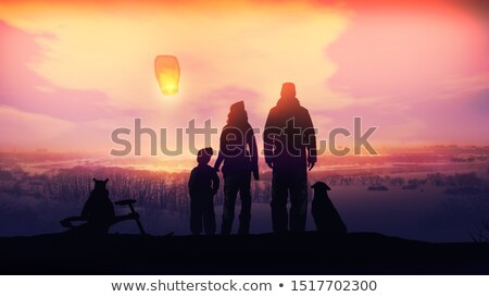 Family launches Chinese lantern on the evening winter walk. Stock photo © ConceptCafe