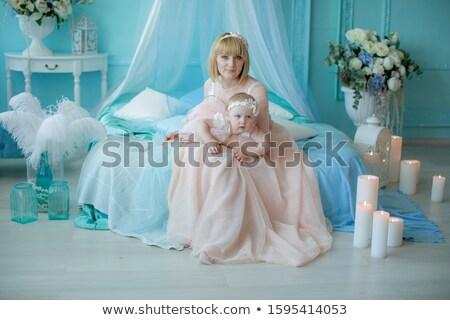 Genç güzel anne pembe yatak odası Stok fotoğraf © ElenaBatkova