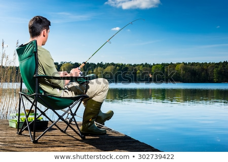 Man with Rod Sitting on Chair, Fishing Hobby Stock photo © robuart