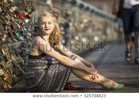 young blonde sits in window on footbridge Stock photo © Paha_L