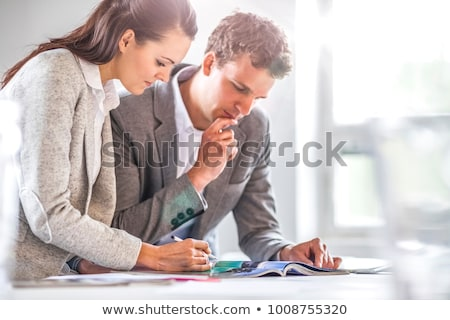 Women in an office looking at a brochure Stock photo © photography33