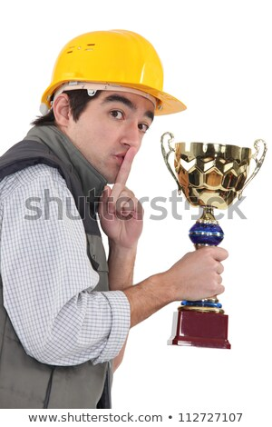 Secretive construction worker with a trophy Stock photo © photography33