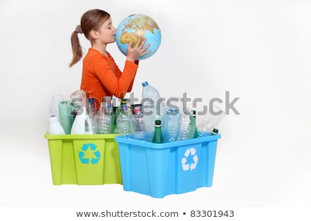 girl recycling bottles and kissing a globe stock photo © photography33