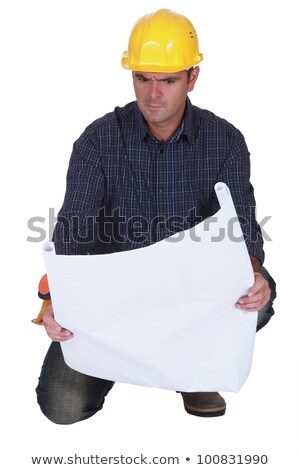 Angry tradesman looking at a technical drawing Stock photo © photography33