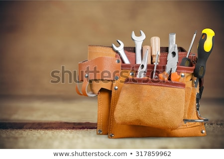 A handyman with a tool-belt. Stock photo © photography33