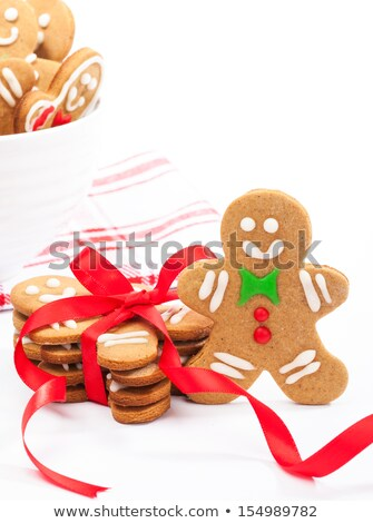 white gingerbread cookies in a white bowl with a red ribbon stock photo © rob_stark