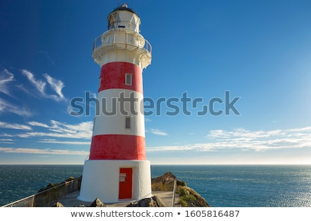 Daytime view of a striped lighthouse Stock photo © adrian_n