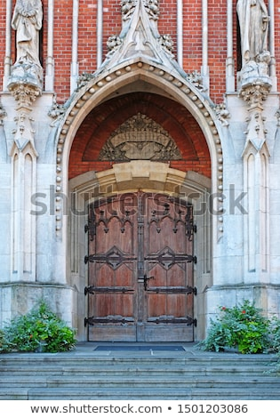 Vintage katholiek kerk deur oude verweerde Stockfoto © hraska