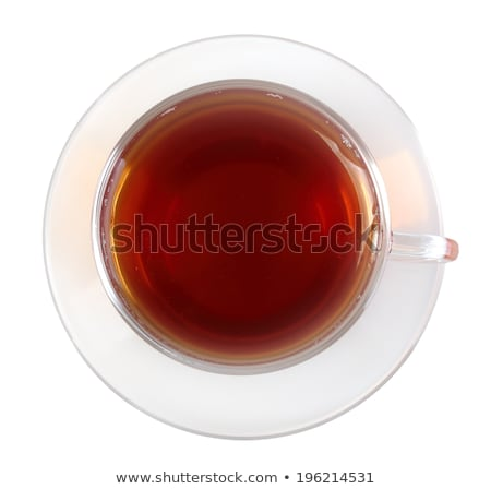 Glasses cup and saucer with black tea stock photo © boroda