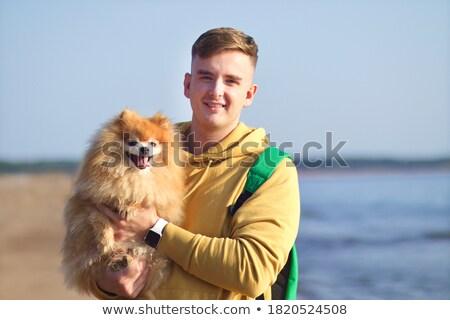Little happy boy holding spitz Stock photo © Nejron