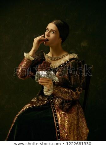 Beautiful girl with a golden chocolate bar Stock photo © Nejron