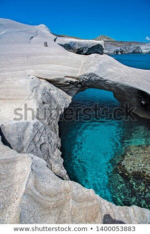 Milos island sea view with rocks and waves Stock photo © ankarb