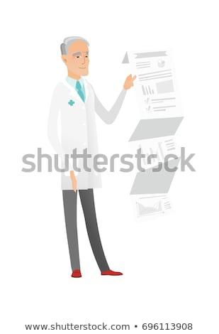 senior doctor in medical gown giving presentation stock photo © rastudio