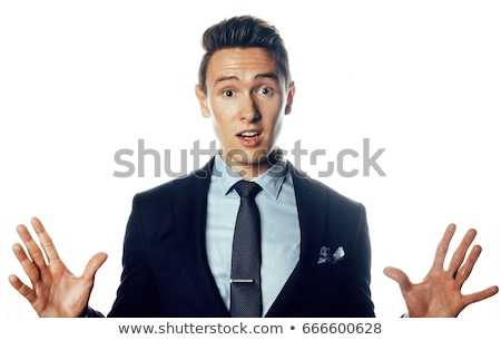 young handsoman businessman fooling aroung isolated on white background, modern real people concept  Stock photo © iordani
