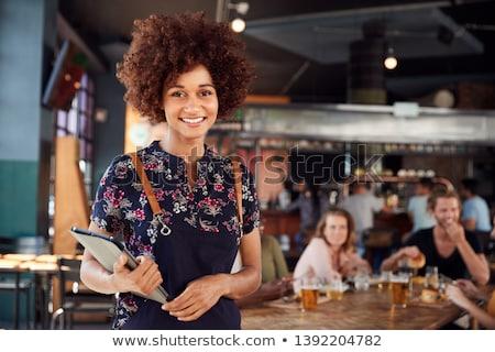 Retrato camarera bebidas alimentos gafas diversión Foto stock © IS2