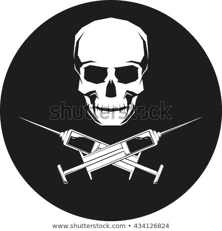 Medical syringe and Skull Stock photo © Klinker