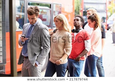 Işadamı otobüs durağı bekleme gıda adam kahve Stok fotoğraf © IS2