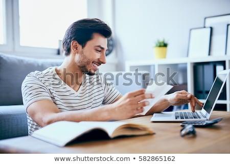 férfi · számológép · csekk · számlák · otthon · számítógép - stock fotó © is2