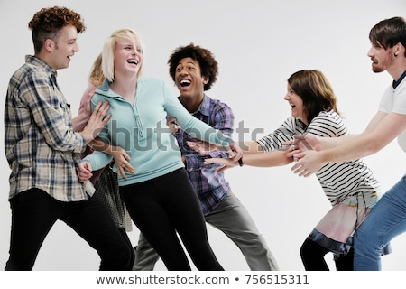 Group of young adults pushing each other Stock photo © IS2