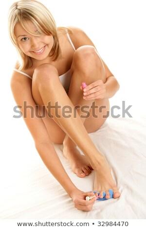 Mujer esmalte de uñas dedo del pie unas dormitorio Foto stock © wavebreak_media