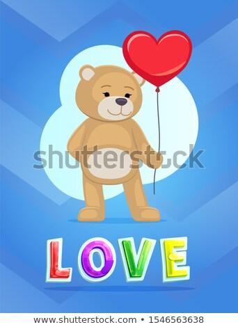love theme teddy bear with big red heart balloon stock photo © robuart