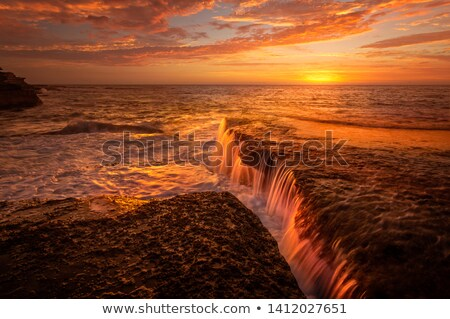 Tidal waterfalls coloured by summer sunrise scenic landscape Australia Stock photo © lovleah