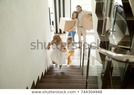 Excited family of two parents and their cute kids in casualwear with suitcases Stock photo © pressmaster