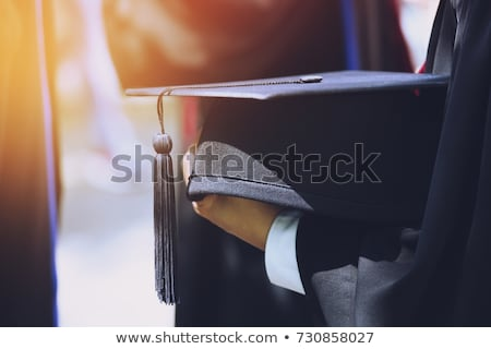 Person's Hand Holding Of Black Graduation Hat Stock photo © AndreyPopov
