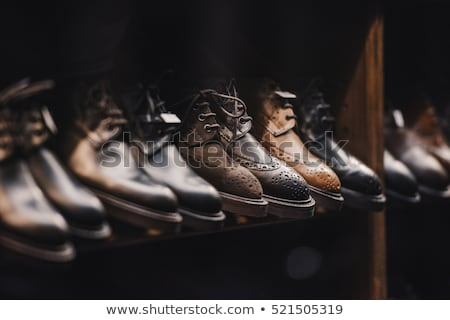 Fashionable mens leather brown shoes on black background. . Men's high boots. Top view. Copy space. Stock photo © Illia