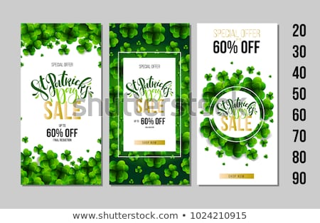 St. Patrick's Day Sale Design, with Green Clover and Typography Letter on Vintage Wood Background. V Stock photo © articular