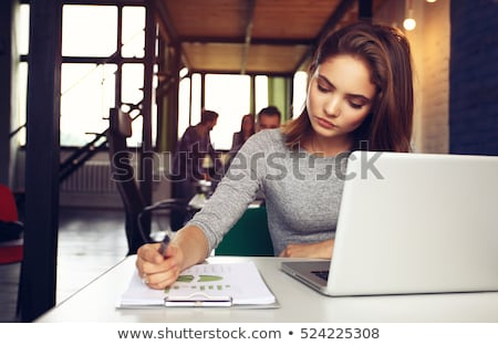 successful young woman with laptop and books stock photo © williv