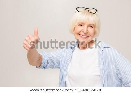 asian senior woman give thumb up stock photo © ampyang