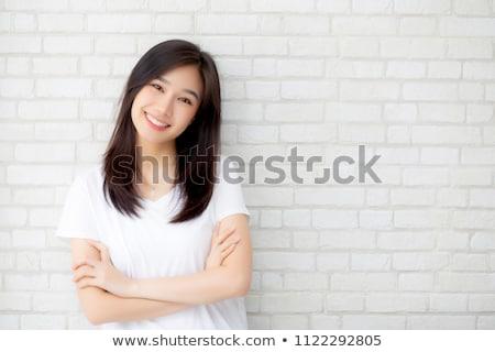 Vonzó ázsiai nő közelkép portré kéz Stock fotó © marylooo