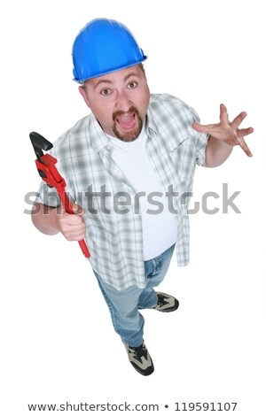 Surprised tradesman holding a pipe wrench Stock photo © photography33